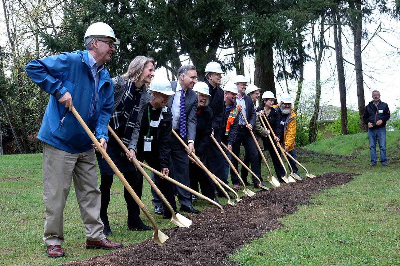 Kailan Manandic/staff photo                                 Officials break ground outside Salt House Church for the Eastside's first permanent women and family shelter. Workers hope to complete construction in 2020.