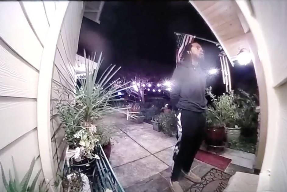 Screenshot of video obtained by Redmond police shows Richard Sherman trying to break into the Redmond home of his in-laws.